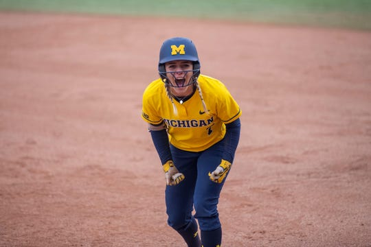 Michigan softball's Madison Uden reacts after getting a hit against James Madison in an NCAA regional softball game on Monday, May 20, 2019 in Ann Arbor.
