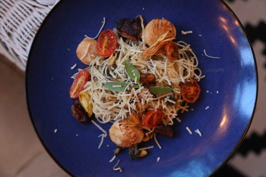 Capellini pasta with seared scallops, enoki mushrooms, smoked mussels and tomatoes, tossed in a lemon and anchovy sauce infused with marijuana. This dish was served during the taping of the inaugural episode of Bonnie's Kitchen, a new web series highlighting cannabis cooking and conversation.
