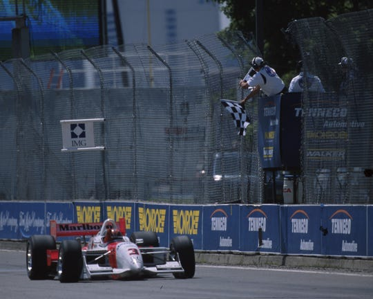 Helio Castroneves of Team Penske earned the first of his three wins at Belle Isle in 2000.