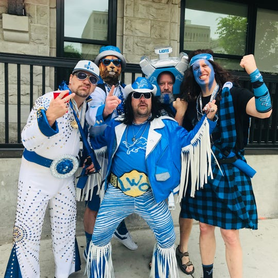 "The ""BlueMane Group"" is a group of Detroit Lions superfans, pictured here at the 2019 NFL draft in Nashville, Tenn. The characters, from left: Detroit Elvis, Lion Heart, Macho Mane (Gary Campioni, of Flint), Motor Head and Detroit Assassin."