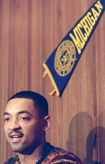 Juwan Howard at an press conference.