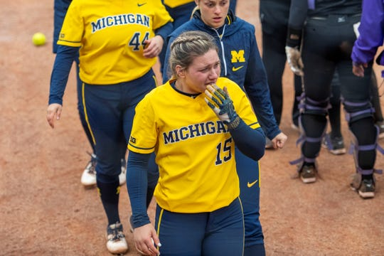 Michigan's Alex Sobczak walks off the field after losing to James Madison in the NCAA softball regional on Monday, May 20, 2019.