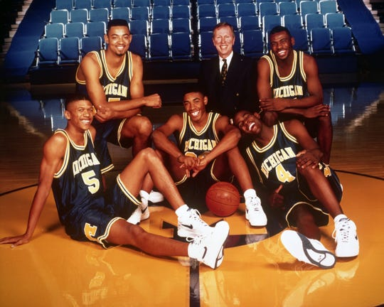 The University of Michigan's Fab Five in 1992. Clockwise from left foreground: Jalen Rose, Juwan Howard, Coach Steve Fisher, Ray Jackson, Chris Webber and Jimmy King.