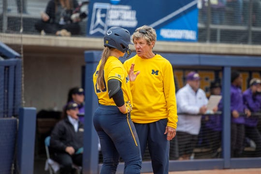Michigan coach Carol Hutchins talks with catcher Hannah Carson during an NCAA regional game against James Madison on Monday, May 20, 2019, in Ann Arbor.