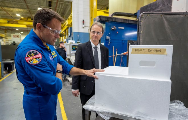 Astronaut Josh Cassada looks at a piece of an internal platform that will be used in the core stage of the Space Launch System (SLS) while being given a tour Tuesday of the Futuramic Tool & Engineering facility in Warren, by Vice President John Couch.