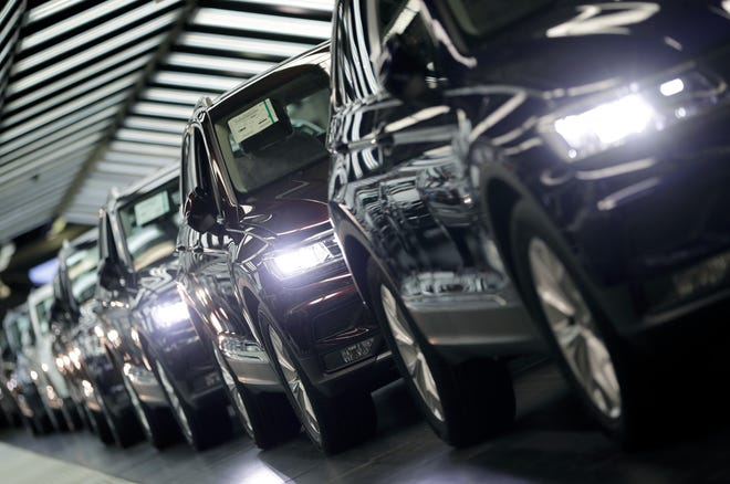 In this March 8, 2018 file photo photo Volkswagen cars are pictured during a final quality control at the Volkswagen plant in Wolfsburg, Germany.