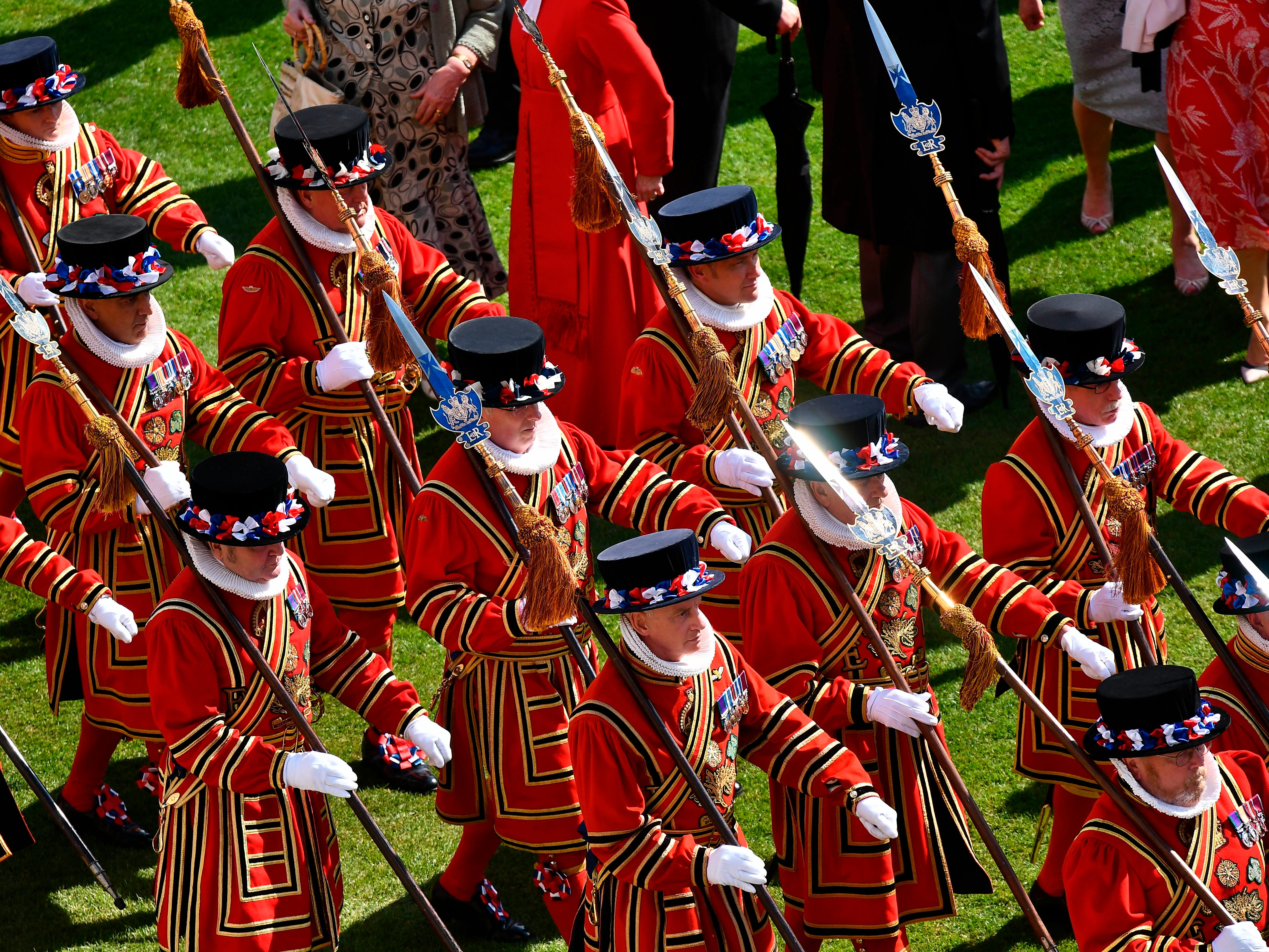 Yeomen of the Guard march is formation at a garden party on the grounds of Buckingham Palace in central London, Tuesday May 21, 2019.