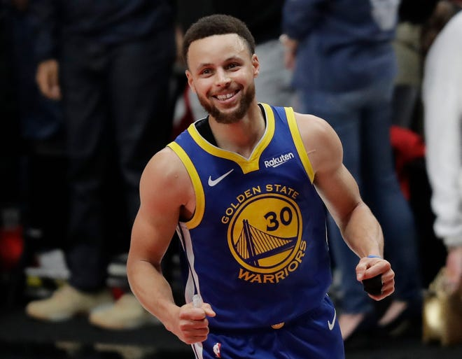 Golden State guard Stephen Curry reacts at the end of Game 4 of the Western Conference finals Monday.