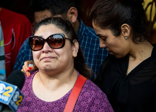 Surrounded by family members and supporters, Marlen Ochoa-Lopez's mother, Raquel Uriostegui, talks to reporters outside the Cook County.