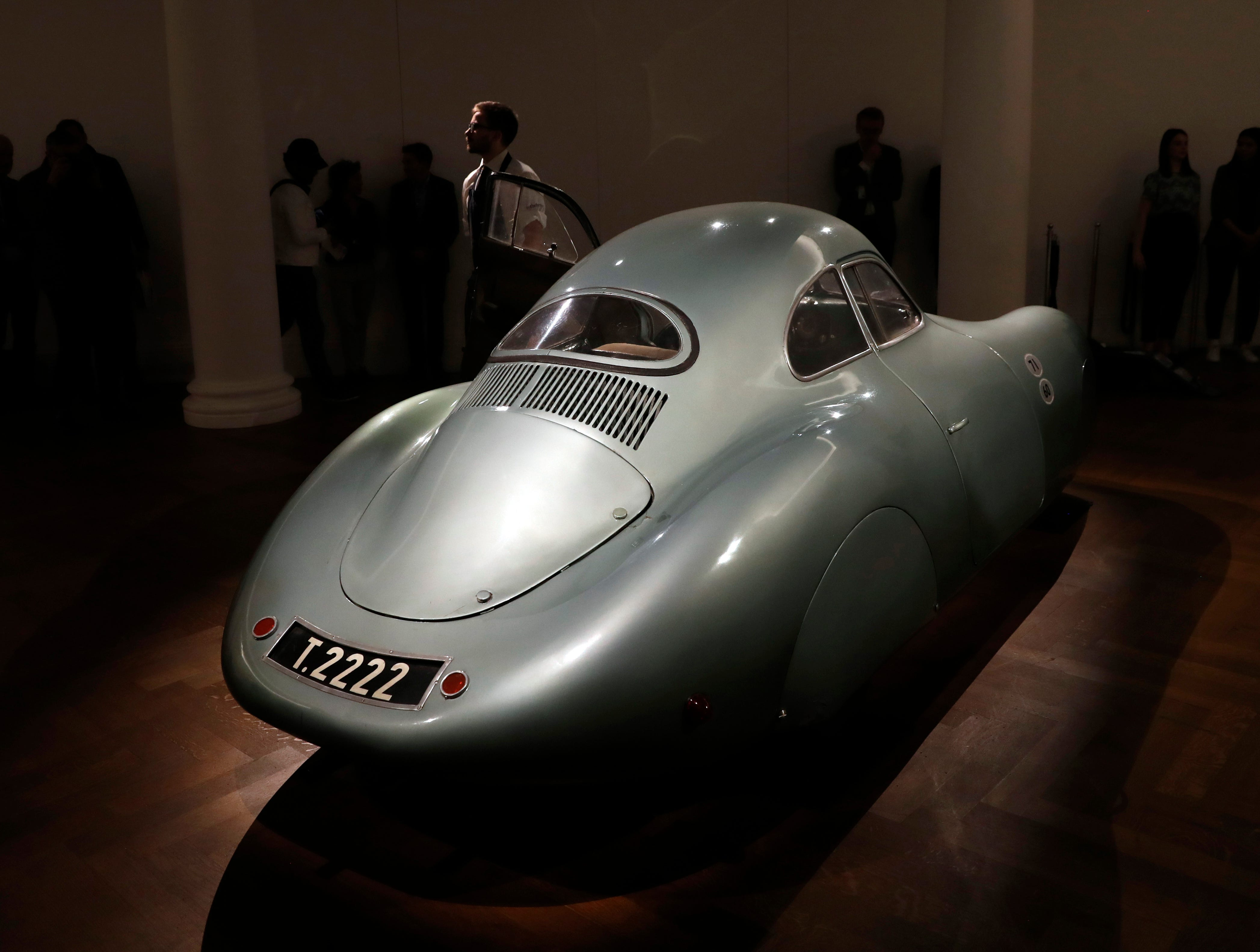 A 1939 Porsche Type 64, the oldest car to wear a Porsche badge and the personal car of German car designer and manufacturer Ferdinand and Ferry Porsche, is on display during a press preview at Sotheby's auction house in London, Tuesday, May 21, 2019. The only surviving example of the Type 64 Porsche, the car will go on sale at an auction in Monterey, California in August and is expected to sell at around $20 million.