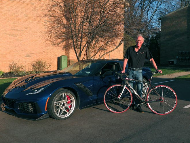 Tadge Juechter, Corvette chief engineer, shows two of his favorite forms of transport, a 2019 Corvette ZR1 and a Specialized S Works racing bicycle.