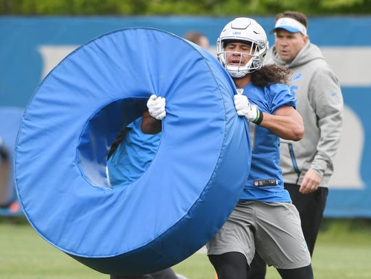 Lions rookie linebacker Jahlani Tavai works through obstacles during drills Tuesday in Allen Park.