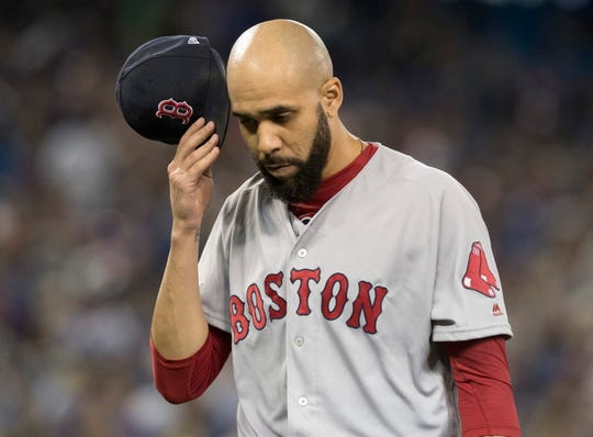Boston starting pitcher David Price comes off the field at the end of the fifth inning Monday.
