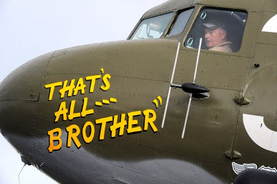 In this April 9, 2019, photo, Pilot Tom Travis sits in the cockpit of the World War II troop carrier That's All, Brother during a stop in Birmingham, Ala.