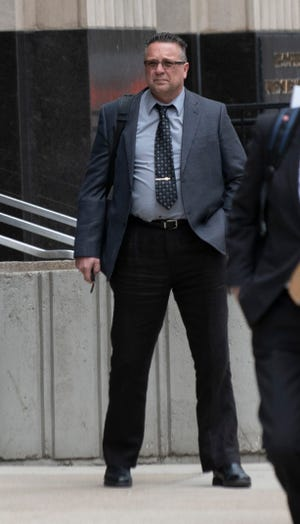 Defendant James Warner, a former field inspector at Detroit Metro Airport who is charged with taking bribes, leaves the Theodore Levin Federal Courthouse in downtown Detroit on May 21, 2019.