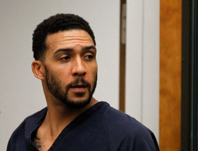 In this June 15, 2018, file photo, former NFL football player Kellen Winslow Jr., center, leaves his arraignment in Vista, Calif.