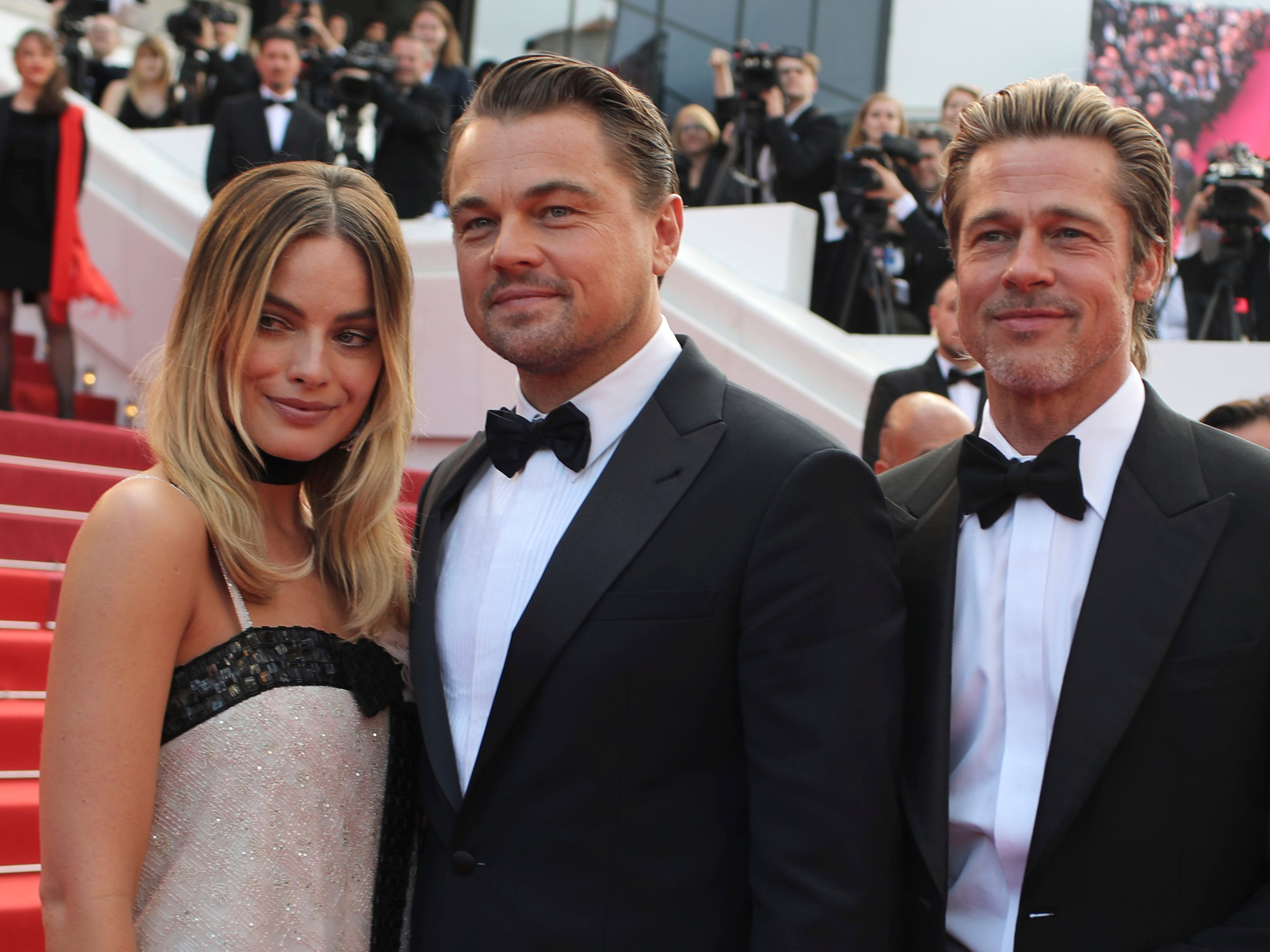 (L-R): Actors Margot Robbie, Leonardo DiCaprio and Brad Pitt poses for photographers upon arrival at the premiere of the film 'Once Upon a Time in Hollywood' at the 72nd international film festival, Cannes, southern France, Tuesday, May 21, 2019.