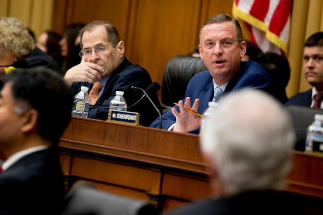 Ranking Member Rep. Doug Collins, R-Ga., right, accompanied by Chairman Jerrold Nadler, D-N.Y., left, speaks at a House Judiciary Committee hearing without former White House Counsel Don McGahn on Capitol Hill in Washington, Tuesday, May 21, 2019.