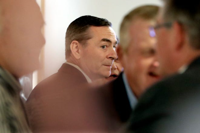 House Speaker Glen Casada, R-Franklin, center, talks with people before a meeting of the House Republican Caucus at a hotel Monday, May 20, 2019, in Nashville, Tenn.
