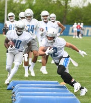 Lions wide receiver Danny Amendola works his way through the obstacles during drills.