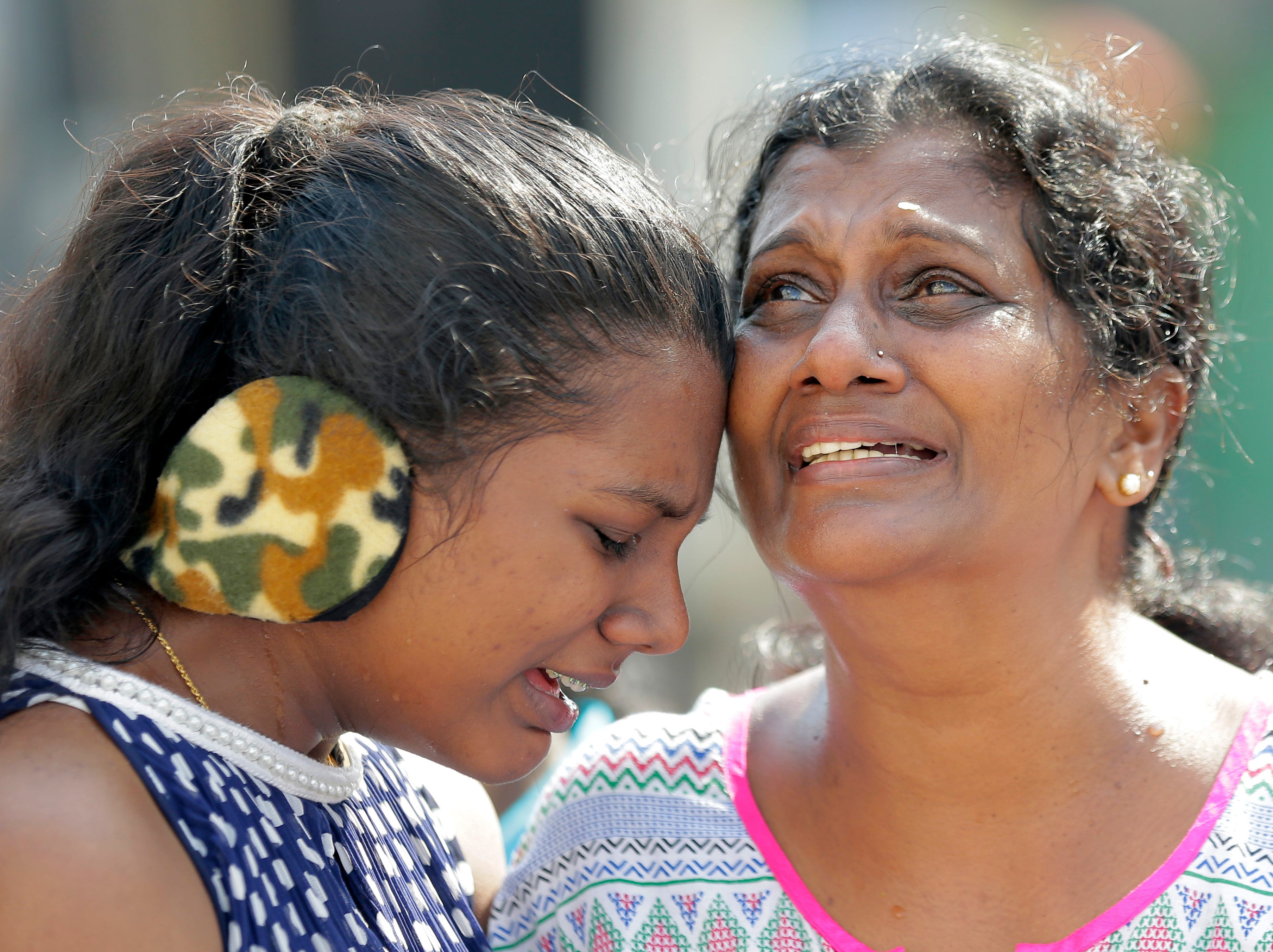 Sri Lankan Roman Catholic devotees cry as they pray outside the St. Anthony's church, one of the sites of Easter Sunday attacks in Colombo, Sri Lanka, Tuesday, May 21, 2019. More than 250 people were killed in coordinated suicide bomb attacks at three churches and three tourist hotels that were claimed by the Islamic State group and carried out by a local radicalized Muslim group.