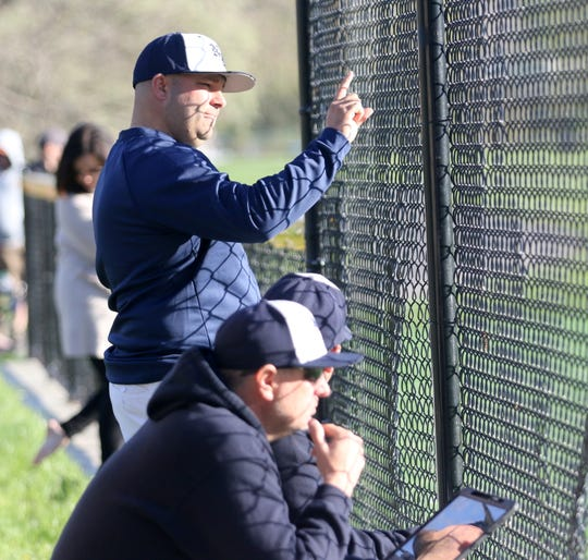Shaun Merrill, top, is in his first season as varsity baseball coach at Elmira Notre Dame.