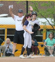 Corning coach Mike Johnston puts up the hold sign after Laura Bennett tripled against Susquehanna Valley during a STAC softball semifinal May 20, 2019 at Corning.