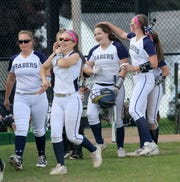 Bella Gaskins, with helmet in hand, is congratulated by teammates after hitting a home run against Corning during a STAC softball semifinal May 20, 2019 at Corning.