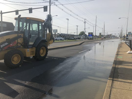 City officials believe a water main break Tuesday afternoon has caused a large sinkhole to form on South Green River Road near Washington Square Mall.