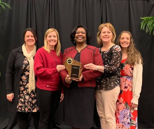 Wisconsin Department of Instruction issued awards recently to Sabish Middle School and Riverside Elementary School in Fond du Lac for outstanding achievement as Title 1 schools. From left are: Stacey Buchholz, Sabish Middle School Principal; Jessica Hughes, Riverside Elementary School Principal; Carolyn Stanford Taylor, Superintendent of Public Instruction; Kristine Wetherall, Riverside Reading Specialist and Amanda Kelm, Sabish Science Teacher.