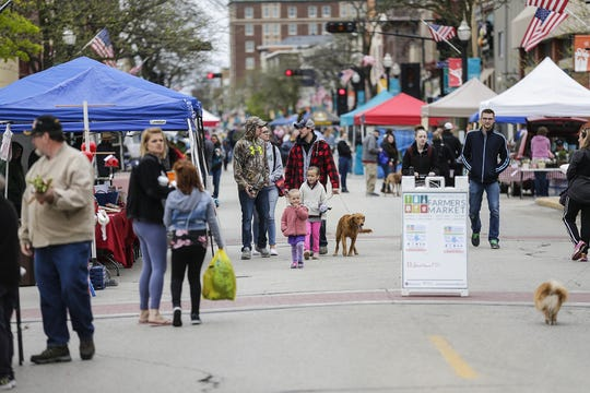 City residents and visitors attend the Farmers Market Saturday, May 18, 2019 in downtown Fond du Lac, Wis.