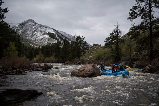 River rafting guides with Rapid Transit Rafting, a company out of Estes Park, Colo., train for their upcoming season on the Cache la Poudre River after an overnight snowstorm in the area on Tuesday, May 21, 2019, in the Poudre Canyon in Larimer County, Colo.