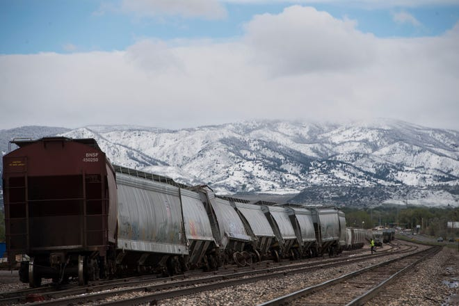 Train cars sit off their tracks across from the intersection of East Vine Drive and Merganser Drive on Tuesday, May 21, 2019, just East of Fort Collins, Colo.