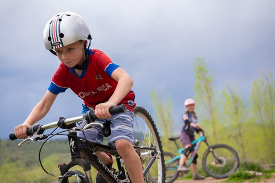 Teresa Bever looks on while one of her sons rides his bike at Spring Canyon Park in Fort Collins, Colo., on Thursday, May 16, 2019.