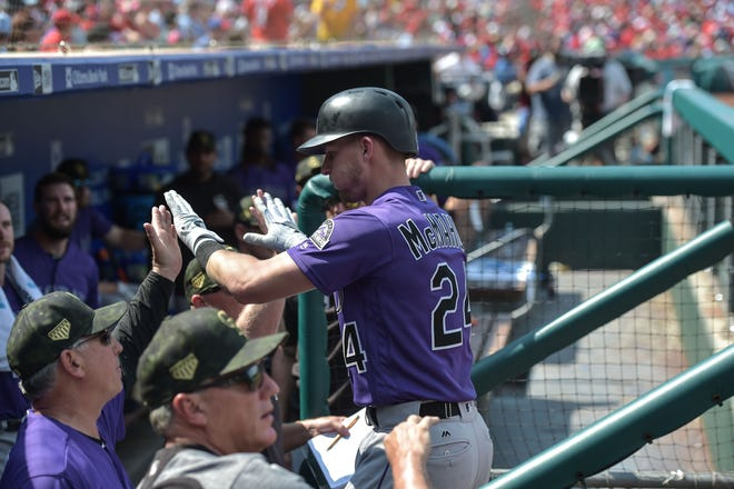 Ryan McMahon of the Colorado Rockies is congratulated in the dugout after hitting a home run Sunday in a game at Philadelphia. The Rockies will play a 5:05 p.m. game Wednesday at Pittsburgh.