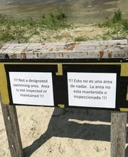 Even though the swimming beach at the Franklin Lock is now closed, people were going into the water anyway, so staff recently put up these sawhorse signs.