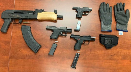 Fort Myers police responding to a possible robbery Monday night stopped a car leaving the scene and found four weapons, arresting a Lehigh Acres man in the process.