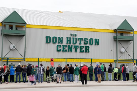 Fans watch the Green Bay Packers practice Tuesday at Clarke Hinkle Field in Ashwaubenon.