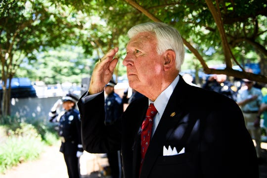 Greenville County Sheriff Johnny Mack Brown salutes during memorial service honoring fallen Greenville County law enforcement officers at the Law Enforcement Center Tuesday, May 21, 2019.