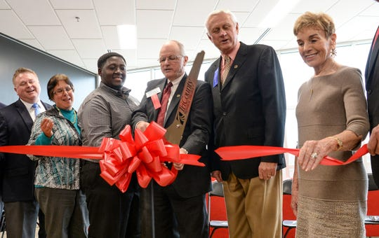 President Ronnie Booth, middle, cuts ribbon near officials, from left; Edda Cammick, Mar'Keese Rayton, John Powell, and Peggy Deane, during the Tri-County Technical College Student Success Center Ribbon Cutting and Dedication Ceremony in Pendleton on Friday, January 12, 2018.