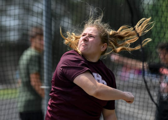 Ashby Greenwell watches her throw as she competes in the discus at the Regional Track Meet held at Colonel Field Tuesday, May 21, 2019.