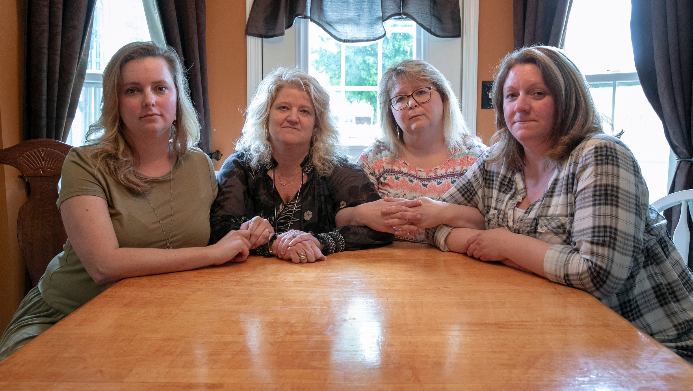 Christian Peachey Travis (left), Brenda King, Missy Haston, and Michelle Brown who worked emergency dispatch during last year's school shootings in Noblesville, lean on each other to get through rough calls they make, Noblesville, Friday, May 17, 2019.