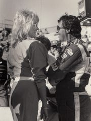 Linda Vaughn, best known as Miss Hurst Golden Shifter, spoke  to driver Mario Andretti in the pits at the Indianapolis Motor Speedway on May 16, 1987.