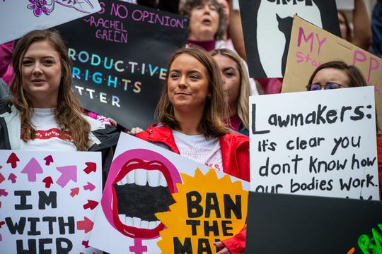Reproductive health supporters gather at the Indiana Statehouse for a 'Stop the Bans' rally against extreme abortion bans on Tuesday, May 21, 2019. The Indiana rally is just one of hundreds being held simultaneously across the country.