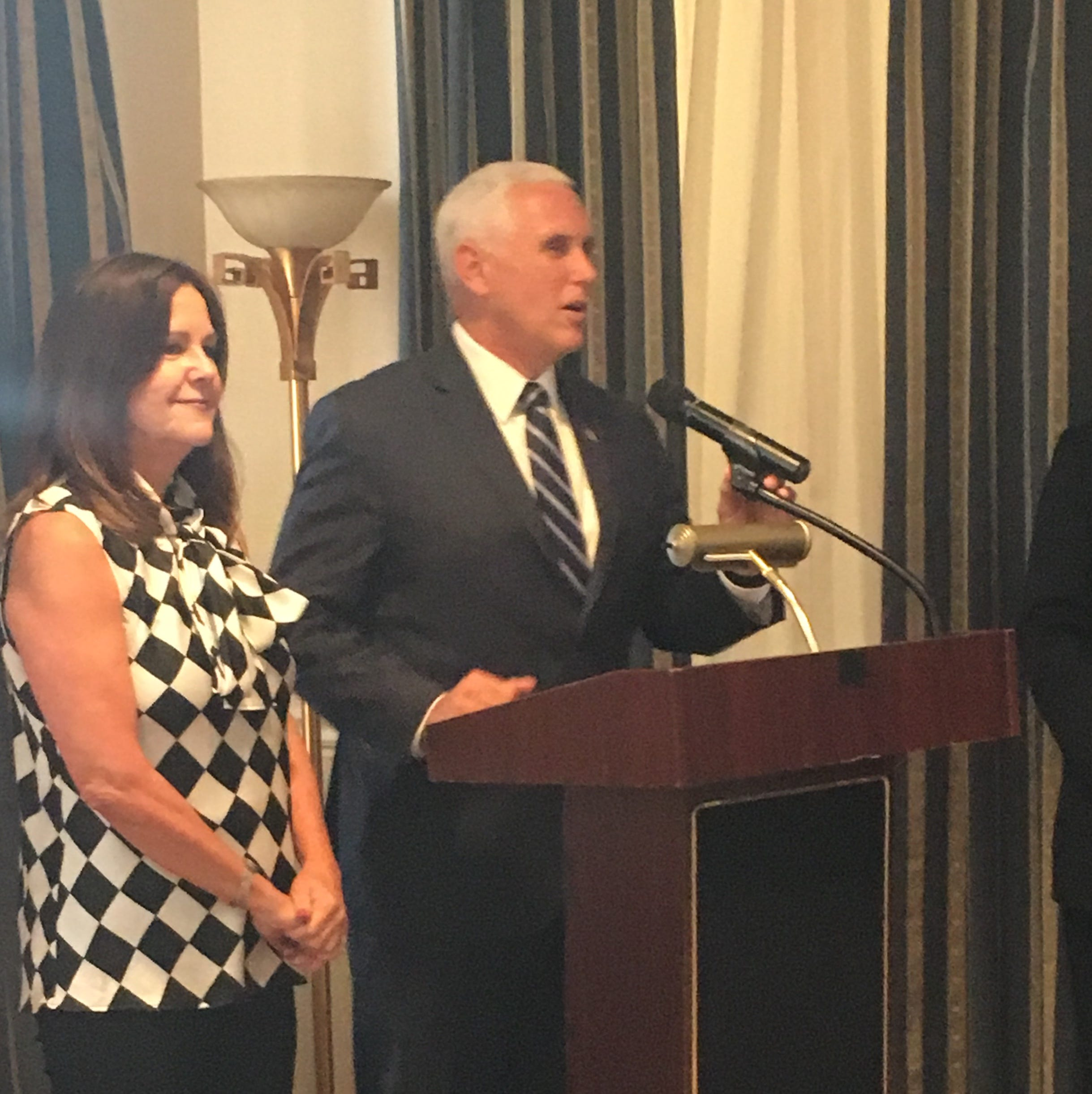 Vice President Mike Pence and his wife, Karen Pence, address the Indiana Society of Washington at a party celebrating the Indianapolis 500.