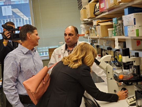 Kelly Trent takes a look at some of Tyler's cells through a microscope as Tony Trent chats with Dr. Reza Saadatzadeh.