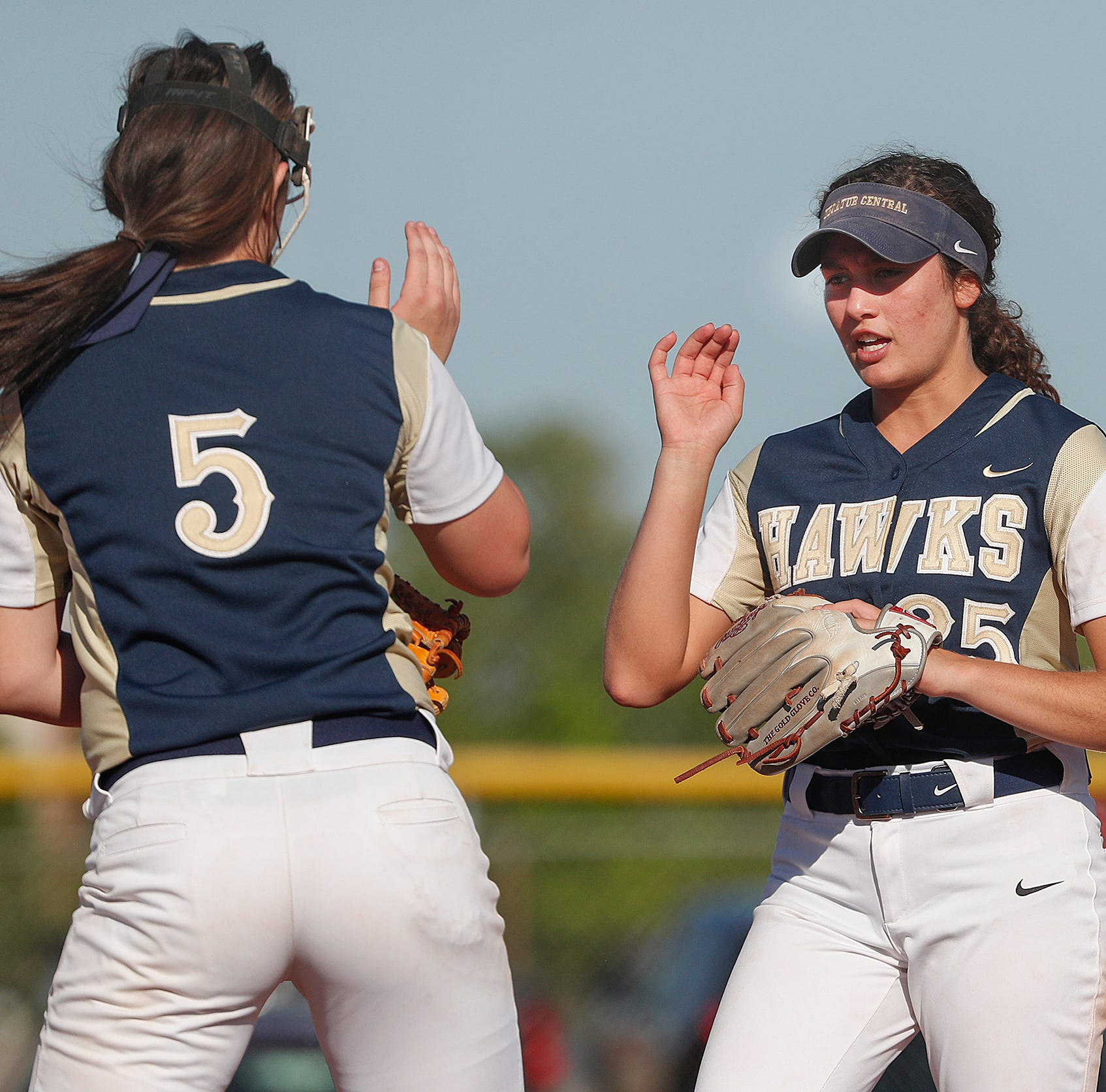 FILE – Kenzee Smith (right) pitched Decatur Central past Roncalli in Monday's sectional opener.