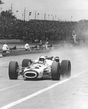 Mario Andretti raced out of the pits during the 1966 Indianapolis 500.  He led 11 laps but a valve problem forced him out.