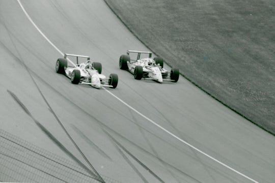Rick Mears passing  Michael Andretti for the last time in turn one in the 1991 Indianapolis 500.