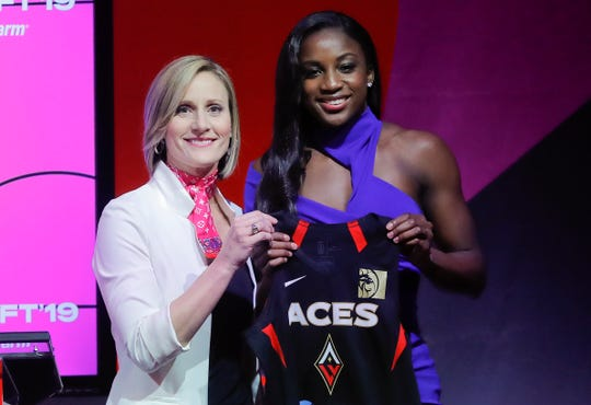 Notre Dame's Jackie Young, right, poses for a photo with WNBA COO Christy Hedgpeth after being selected as the number one pick in the draft by the Las Vegas Aces in the WNBA basketball draft,, April 10, 2019, in New York.